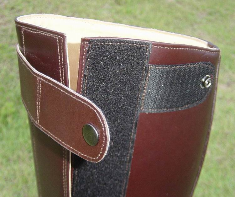 Side velcro closure with velcro-snap buckle to secure.
